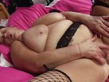 naked mature rubs&fingers herself